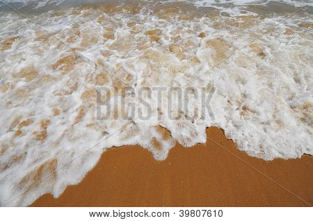 white spume at beach