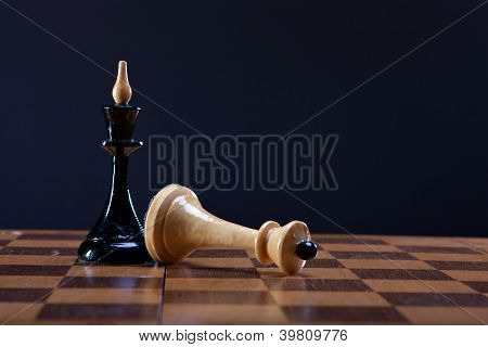 victory over king Queen in chess
