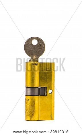 Old Lock Brass Cartridge Cylinder With Key  On White