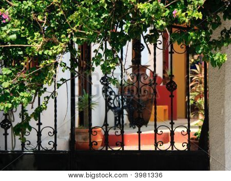 Ornate Iron Gates With Patio