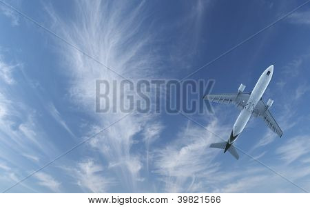 Passenger Aircraft Flying In Blue Sky