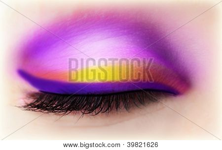 Image of purple eye makeup, one closed eyeball with beautiful violet and golden eyeshadow, face part, luxury magenta makeover, beautiful black mascara, fashionable cosmetics, beauty salon