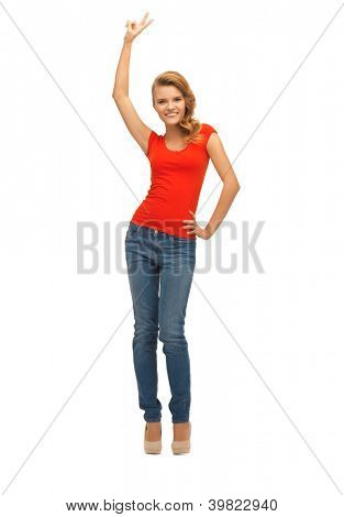 picture of teenage girl in red t-shirt showing victory sign