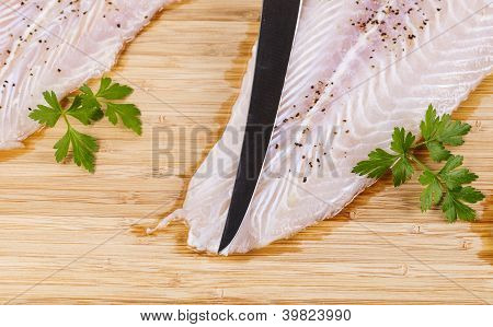 Clean And Seasoned Fish Fillets With Sharp Knife