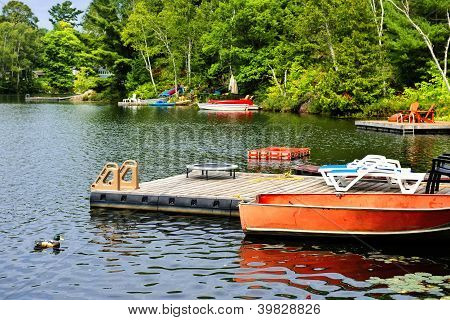 Cottage Lake With Diving Platform And Docks
