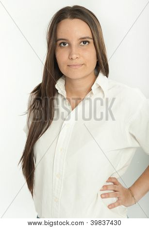 Serious long haired brunette in a white shirt