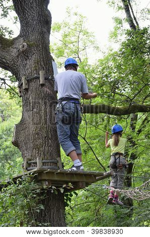 Children At Ropes Course On The Trees