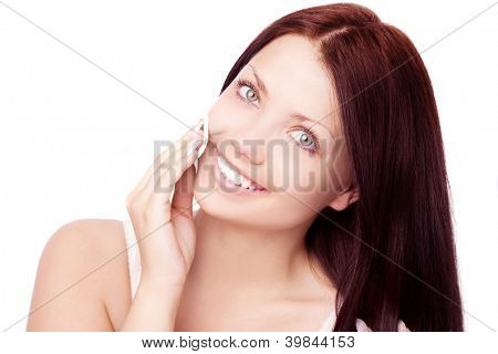 beautiful young brunette woman using cotton pads, isolated against white background