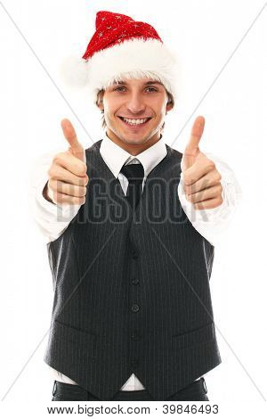 Happy man in office suit with christmas hat in studio