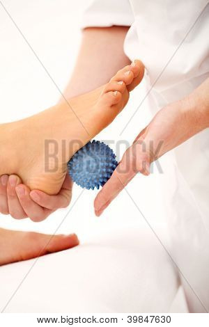 Enjoying and relaxing healthy foot massage close up