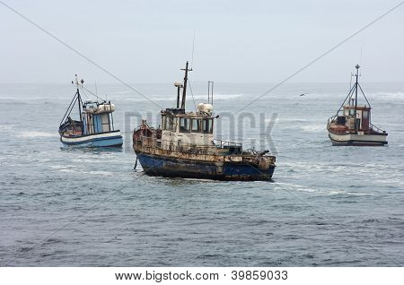 Fishing vessels at sea