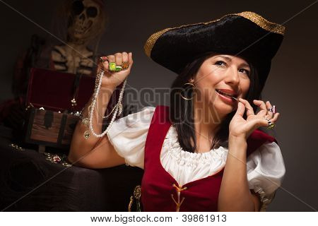 Dramatic Female Pirate Biting a Coin in a Dimly Lit Moody Scene.