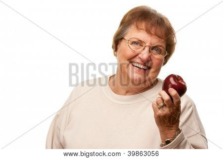 Attractive Senior Woman with Red Apple Isolated on a White Background.