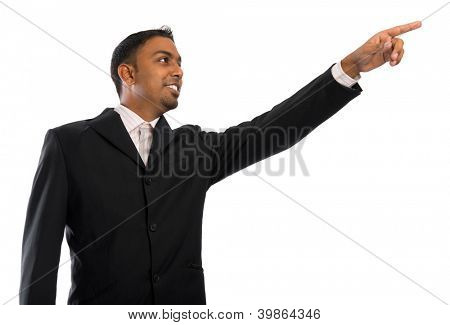Asian Indian businessman pointing to blank space, isolated on white background