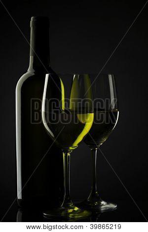 white wine glass silhouette black background