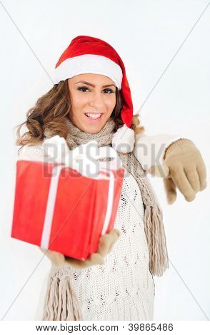 Young girl in christmas suit with gift