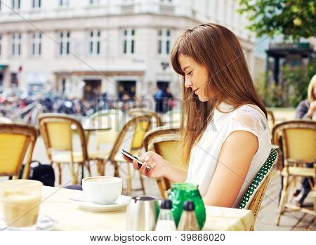 Attractive Woman Reading A Text Message