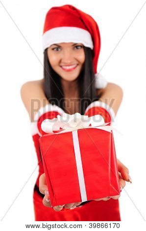 Isolated young christmas girl giving gift