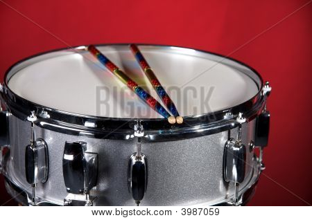 Silver Sparkel Snare Drum Isolated On Red