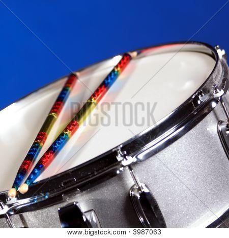 Silver Sparkle Snare Drum Ans Sticks On Blue