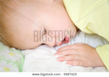 Restful Baby Boy Sleeping On Bed