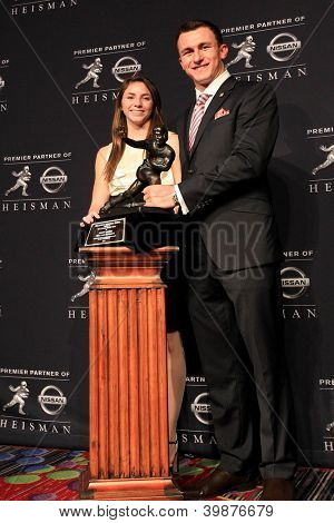NEW YORK-DEC 8: W.B. Ray high schooler Zoe Alaniz and Texas A&M quarterback Johnny Manziel are the winners of the 2012 Heisman trophy at the Marriott Marquis on December 8, 2012 in New York City.