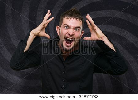 Portrait Of Frustrated Man against a spiral background