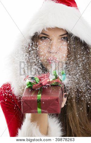 Santa Girl Blowing Snow
