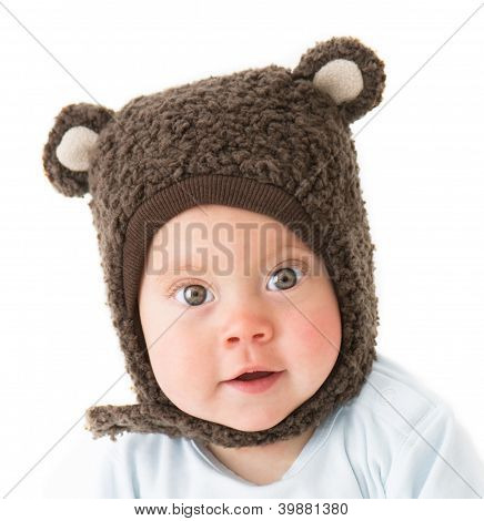 Little Boy In A Cap With Ear Flaps