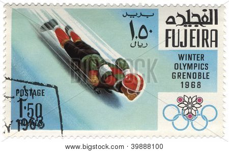 Toboggan At The Winter Olympics In Grenoble On Postage Stamp