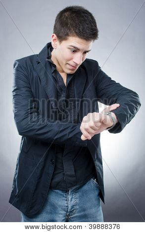 Young Man Looking At His Watch