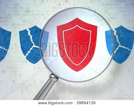 Magnifying optical glass with shields icons on digital backgr