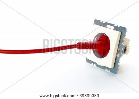 Red Power Cable Plugged Into Wall Outlet