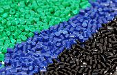 stock photo of thermoplastics  - three different dyed polymer resin for injection moulding  - JPG