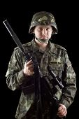 pic of m16  - Armed soldier grasping m16 in studio - JPG