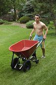 Teenager Pushing Wheelbarrow