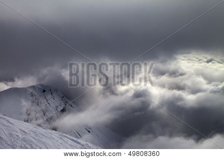 Off-piste Slope And Snowy Rocks In Bad Weather