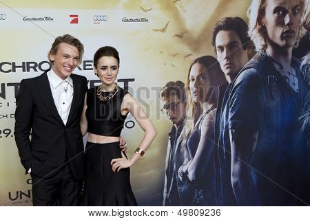 BERLIN - AUG 20:  Jamie Campbell Bower, Lily Collins at the 'The Mortal Instruments: City of Bones' premiere at Sony Center on August 20, 2013 in Berlin, Germany