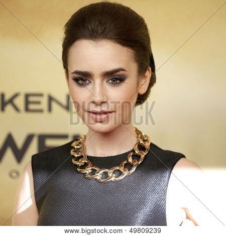 BERLIN - AUG 20: Lily Collins at the 'The Mortal Instruments: City of Bones' premiere at Sony Center on August 20, 2013 in Berlin, Germany