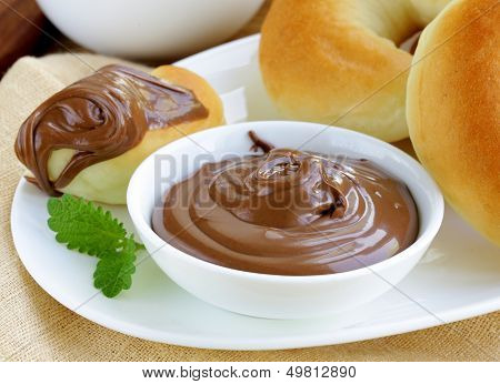 Chocolate nut paste (nutella) for breakfast with bread rolls