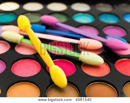Multicolored Eye Shadows And Cosmetics Brush