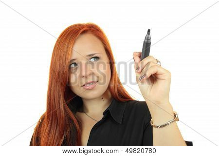 Young business woman writing or drawing on screen with black marker, isolated over white background