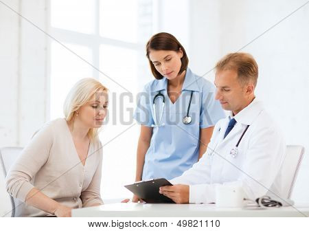 healthcare and medical concept - doctor and nurse with patient in hospital