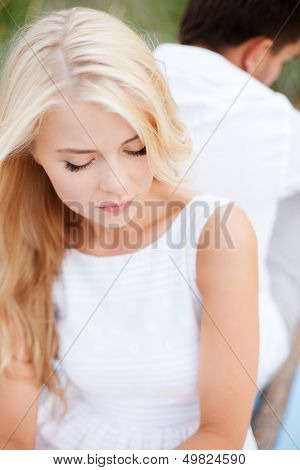 dating and relationships concept - stressed woman with man outside