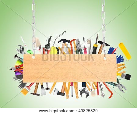 Many different tools with signboard on green background
