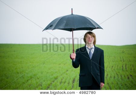 Handsome Young Businessman With Umbrella