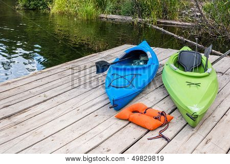 Kayaks and Life Jacket on Fishing Pier