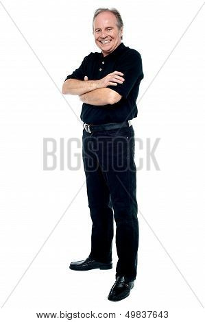 Happy Man In Black Attire Posing With Arms Folded