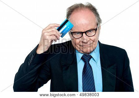 Businessman Scratching His Forehead With Plastic Card
