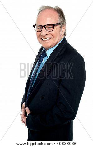 Bespectacled Businessman Posing Sideways